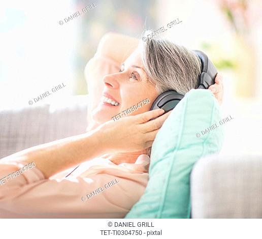 Portrait of woman listening to music