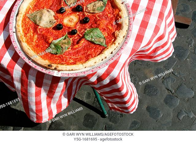 display pizza on table outside restaurant in rome italy