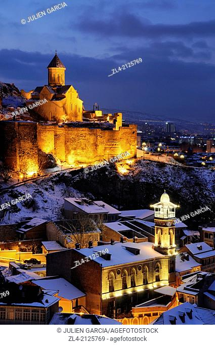 The old town with the mosque, the Narikala fortress and St Nicholas church in a winter evening. Georgia, Caucasus, Tbilisi