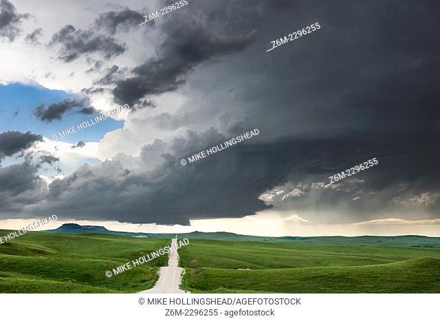Supercell storm with small tornado moves across the badlands area of southwest South Dakota near Kadoka, June 7, 2005