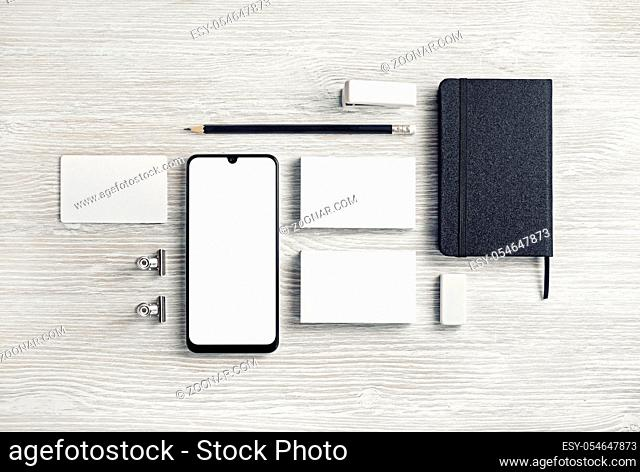 Blank corporate stationery for branding design. Corporate identity set on light wood table background. Flat lay