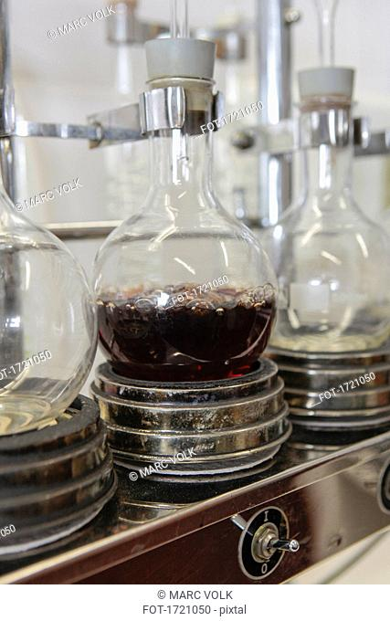 Close-up of wine boiling in flask at laboratory