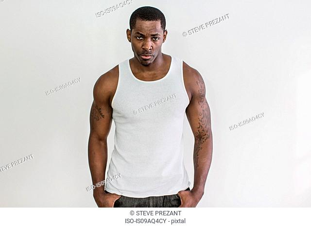 Studio portrait of muscular macho mid adult man