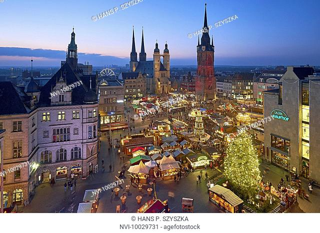 Christmas market with Marktkiche St. Mary and Red Tower in Halle / Saale, Saxony-Anhalt, Germany