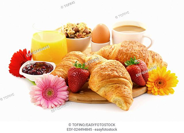Composition with breakfast on the cutting board isolated on white