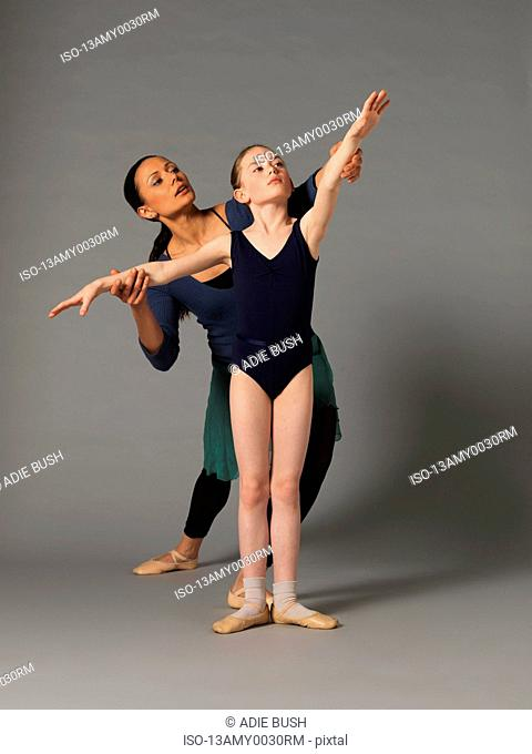 Woman teaching girl ballet
