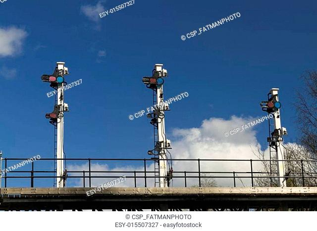 Shunting signals on gantry over railway line