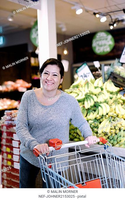Woman doing the groceries shopping