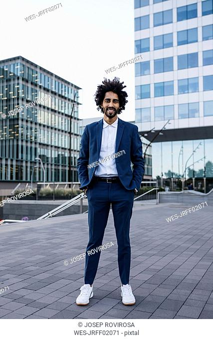 Spain, Barcelona, portrait of stylish young businessman standing in the city