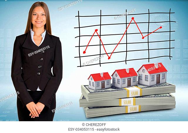 Businesswoman with houses and packs dollars. Schedule of price increases in background
