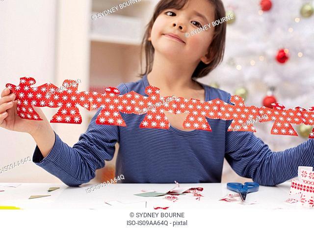 Girl holding Christmas decoration, portrait