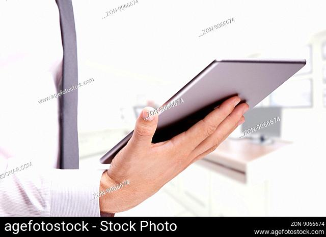 double exposure of businessman with tablet on building background
