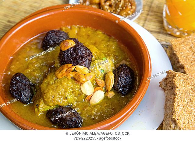 Moroccan food. Traditional dish on a typical restaurant, Tajine of lamb with plums and almonds. Medina of Fez, Fes el Bali