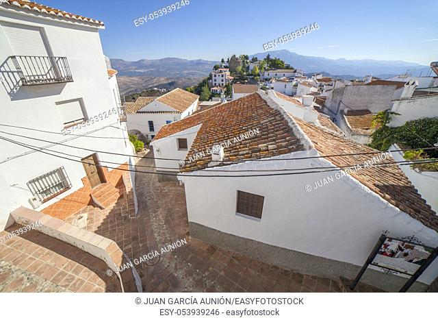 Viewpoint from Verdiales Square to Moorish Fortress in Comares, Malga, Spain. Vhite village up on the hill called Axarquía Balcony