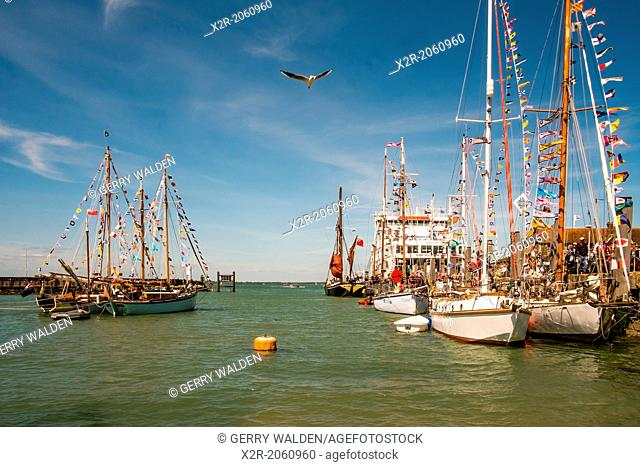 Various vessels in the harbour at Yarmouth, Isle of Wight, England during the Old Gaffers Festival