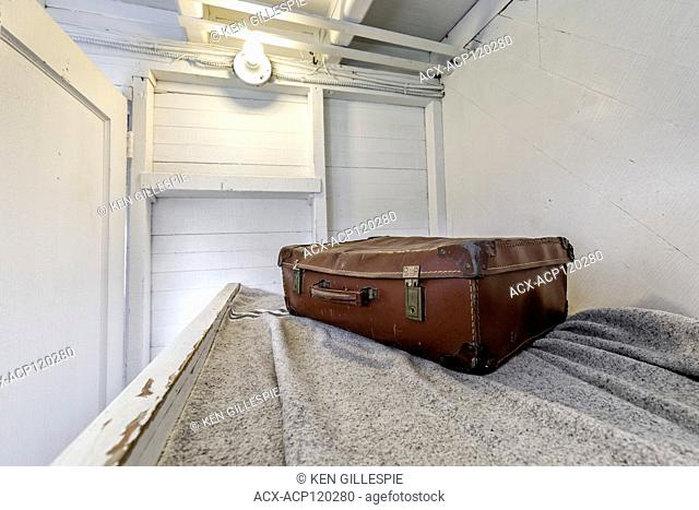 Vintage luggage on a ships passenger cabin bunk at the Marine Museum of Manitoba, Selkirk, Manitoba, Canada