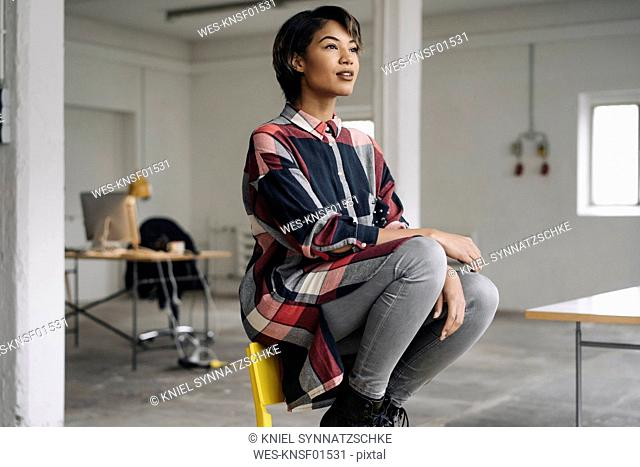 Woman sitting on chair thinking