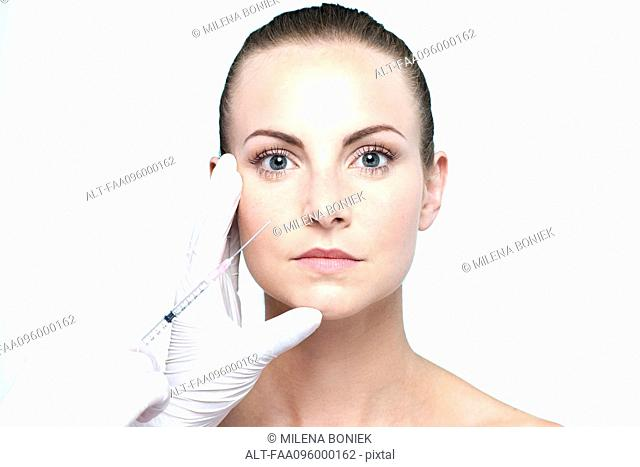 Woman receiving collagen injection
