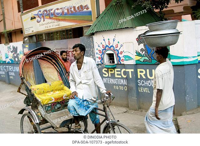 Cycle Rickshaw Rider Waiting for Passenger on street at Dhaka ; Bangladesh