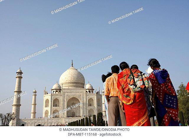 Family in front of Taj Mahal Seventh Wonders of World on the south bank of Yamuna river , Agra , Uttar Pradesh , India UNESCO World Heritage Site