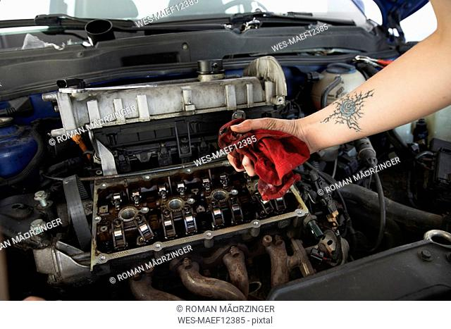 Woman's hand cleaning engine