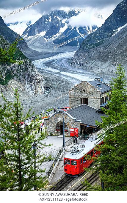 Montenvers train at Mer de Glace Station overlooks glacier and Grandes Jorasses; Chamonix-Mont-Blanc, Haute-Savoie, France