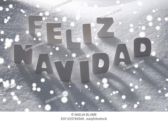 White Wooden Letters Building Spanish Text Feliz Navidad Means Merry Christmas. Snow And Snowy Scenery, Snowfalkes. Christmas Atmosphere