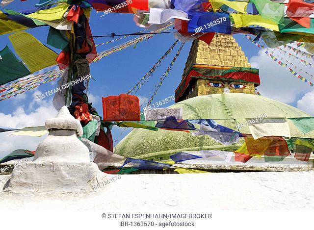View through prayer flags on Buddhist stupa of Bodhnath, Kathmandu, Nepal, Asia