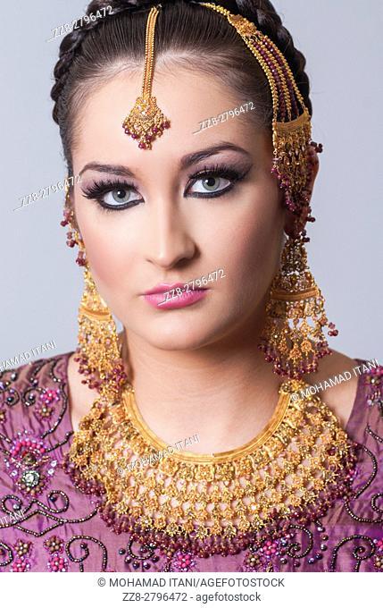 Beautiful Asian bride staring