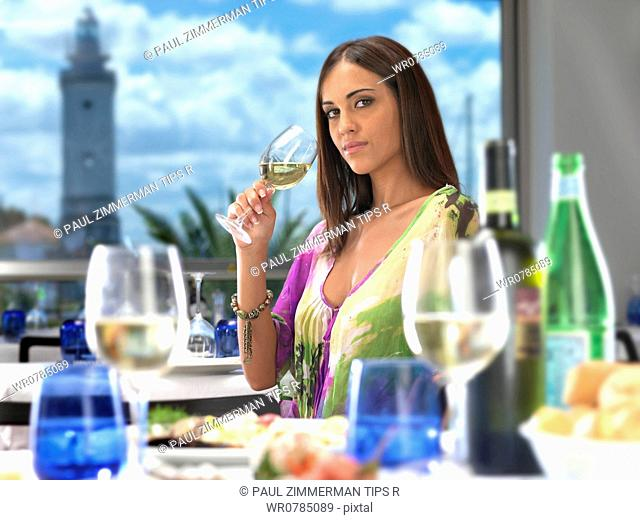 Woman at restaurant drinking white wine