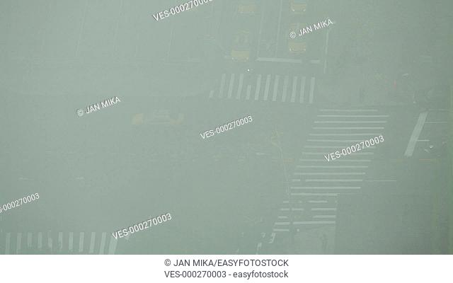 New York City, USA - 19 May 2015: Fast motion of traffic during foggy day on the crossroad of First Avenue and East 42nd Street in Midtown Manhattan