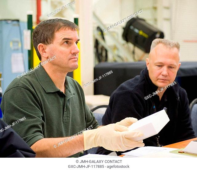 NASA astronauts Rex Walheim (left), STS-135 mission specialist; and Doug Hurley, pilot, participate in an EVA Thermal Protection System (TPS) overview training...