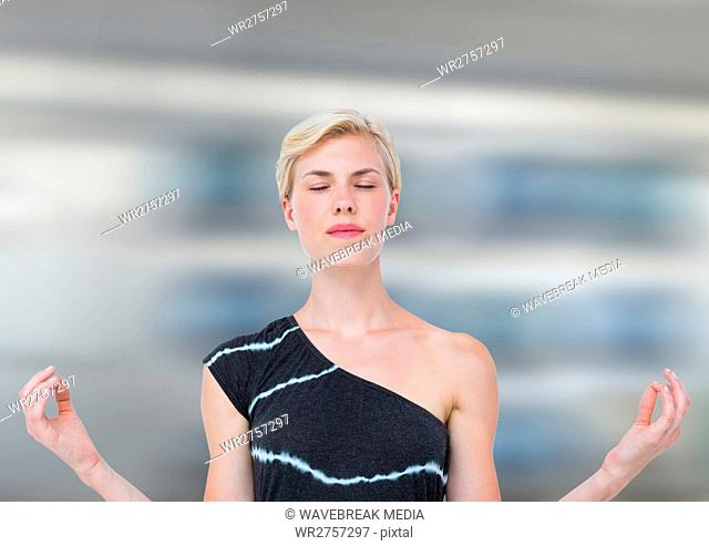 Woman Meditating peaceful against motion blur background