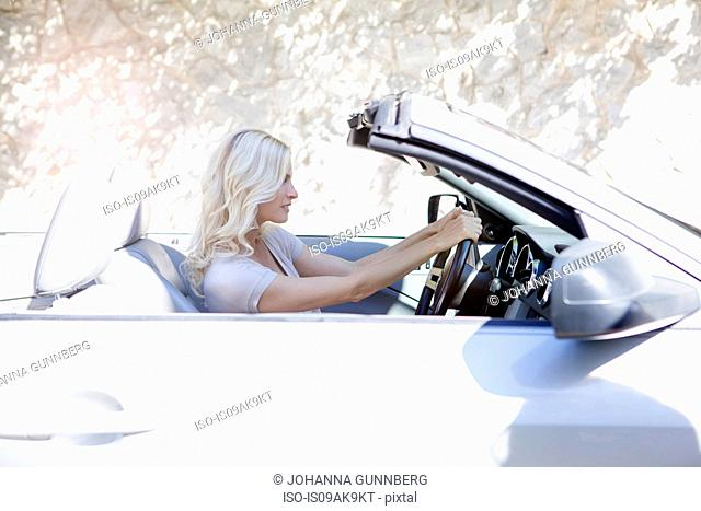 Woman in her convertible car