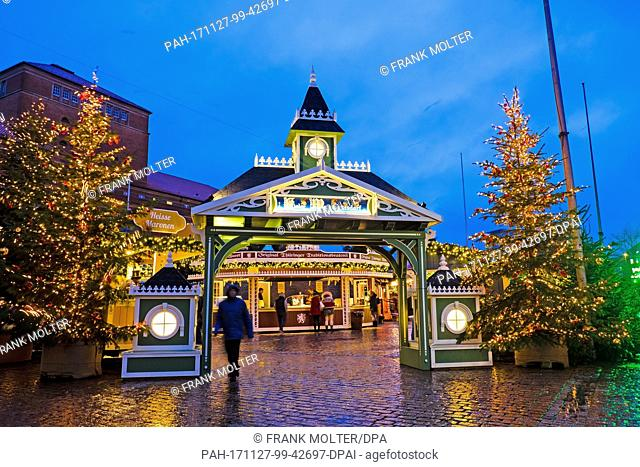 The entrance of the Kiel Christmas market glows in a festive setting in Kiel, Germany, 27 November 2017. The market has been open since 5pm and will close on 23...