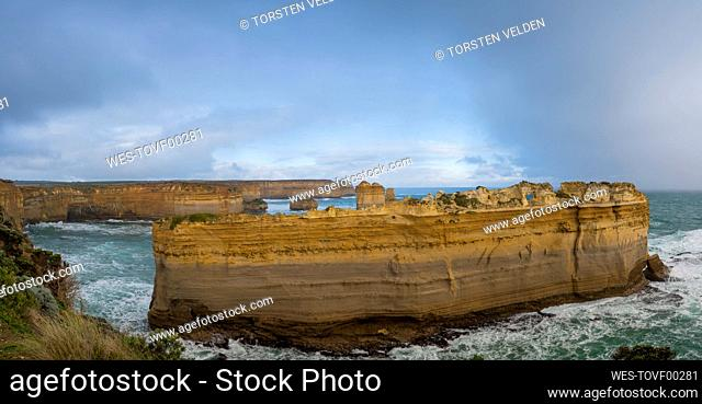 Rocky cliffs in sea at Great Ocean Road