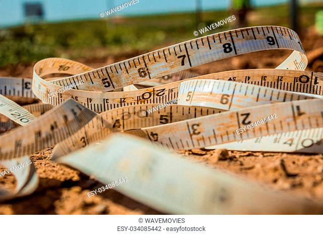 Measuring tape placed on the ground at a construction site