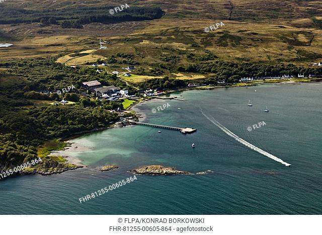 Aerial view of coastline with village and pier, Craighouse, Small Isles Bay, Isle of Jura, Inner Hebrides, Scotland