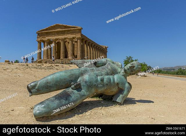 Ikaro caduto (fallen Icarus) bronze sculpture by Polish artist Igor Mitoraj in front of the Temple of Concordia (Greek: Harmonia) , built c