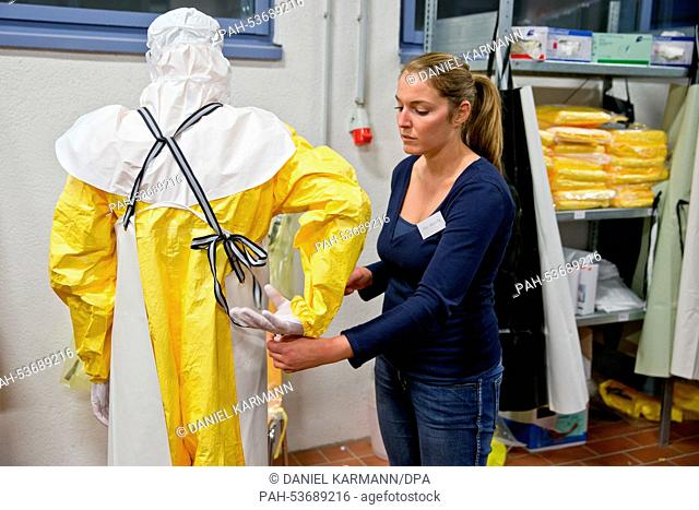 Health professional Christian Kleine explains the proper way to put on protective clothing at an Ebola training seminar in Wuerzburg, Germany, 03 November 2014
