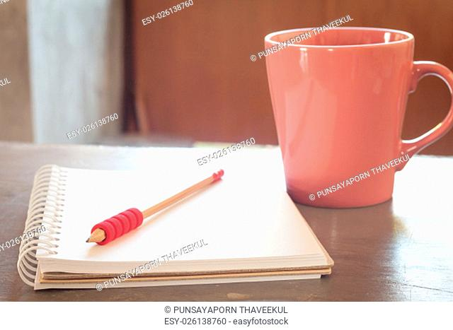 Blank notebook with pencil on grey background, business concept
