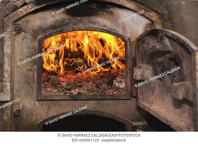 Fire wood in ancient rust stove