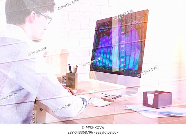 Side view of young businessman at abstract workplace using computer with forex chart on screen. Future and investment concept. Double exposure