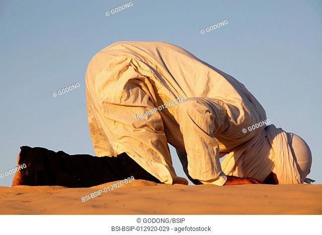 Beduin praying in the Sahara