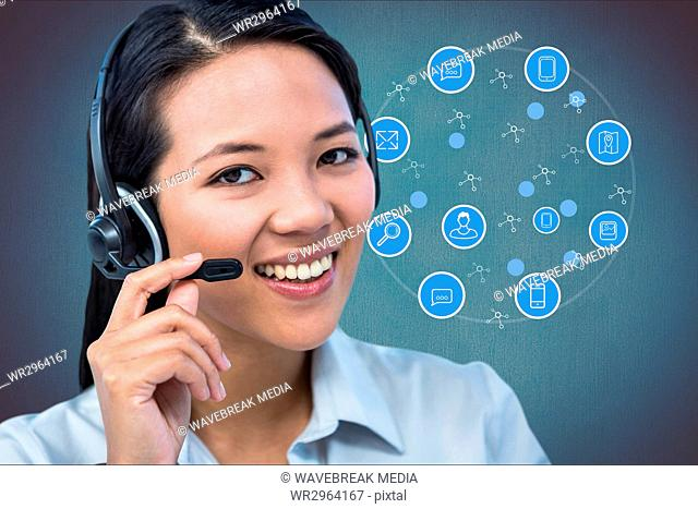 Woman with headphones smiling against digital icons