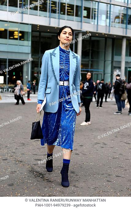 Caroline Issa, Editor of Tank Magazine, posing outside of the Christopher Kane runway show during London Fashion Week - Sept 18