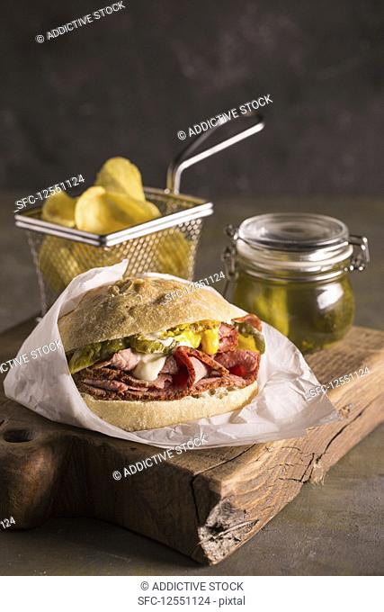 Delicious pastrami sandwich with pickles, mustard and mayo