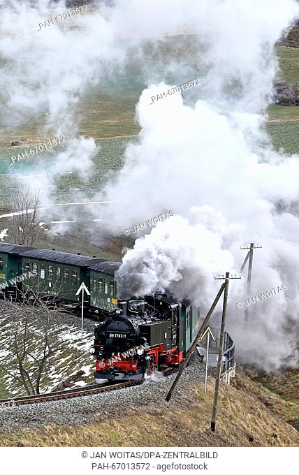 The Fichtelberg mountain railway going uphill from Cranzahl towards Oberwiesenthal, Germany, 21 March 2016. According to the Saxonian Steam Train Society (SDG)
