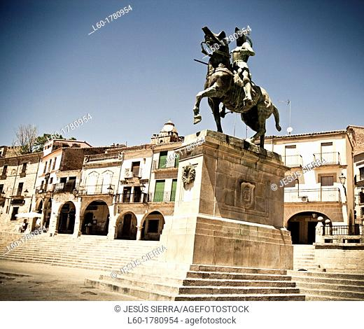 Statue of Pizarro and St  Martin's church 15th-16th century in Main Square, Trujillo  Caceres province, Extremadura, Spain