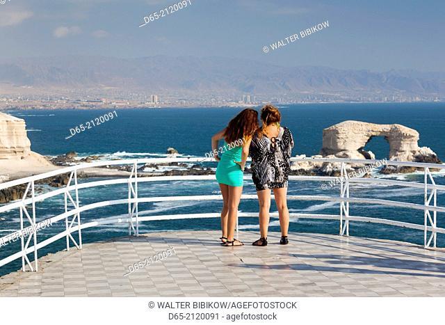 Chile, Antofagasta, La Portada rock formation with visitors
